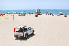 Lifeguard Truck Approaches Observation Tower Royalty Free Stock Images