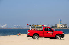 Lifeguard truck on beach. Red lifeguard truck on sandy beach Stock Image