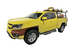 Lifeguard truck. Yellow Lifeguard truck with equipment rack on the back Royalty Free Stock Images