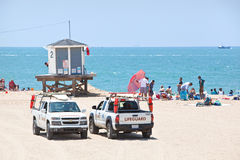 Lifeguard Trucks Parked by an Observation Tower Stock Photos