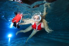 Lifeguard underwater in the pool Stock Photo