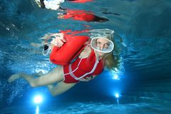 Lifeguard underwater in the pool Stock Image