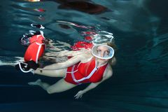 Lifeguard underwater in the pool Stock Photos