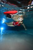 Lifeguard underwater in the pool Royalty Free Stock Photography