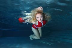 Lifeguard underwater in the pool Stock Images