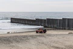 Lifeguard Vehicle Waits on Beach Near International Border Wall in Mexico royalty free stock photos