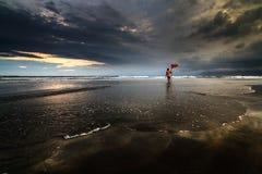 Lifeguard with warning flag stock photography