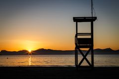 Lifeguard watchtower on Alcudia beach at sunrise Royalty Free Stock Photography