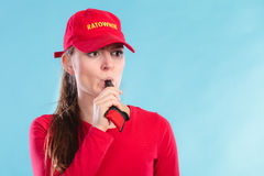 Lifeguard woman in cap on duty blowing whistle. Stock Photography