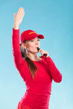 Lifeguard woman in cap on duty blowing whistle. Stock Photos