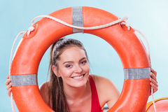 Lifeguard woman on duty with ring buoy lifebuoy. Happy lifeguard with ring buoy lifebuoy. Woman girl supervising swimming pool water. Accident prevention Stock Images