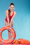 Lifeguard woman on duty with ring buoy lifebuoy. Royalty Free Stock Photography
