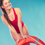 Lifeguard woman on duty with ring buoy lifebuoy. Stock Images
