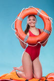 Lifeguard woman on duty with ring buoy lifebuoy. Royalty Free Stock Images