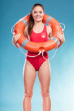 Lifeguard woman on duty with ring buoy lifebuoy. Stock Photo