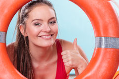 Lifeguard woman on duty with ring buoy lifebuoy. Happy lifeguard with ring buoy lifebuoy. Woman girl supervising swimming pool water giving thumb up. Accident royalty free stock photo