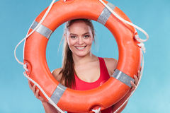 Lifeguard woman on duty with ring buoy lifebuoy. Stock Photography