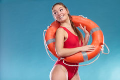 Lifeguard woman with ring buoy lifebuoy. Lifeguard woman girl with ring buoy lifebuoy supervising Royalty Free Stock Image