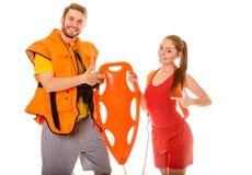Lifeguards στη φανέλλα ζωής με το σημαντήρα διάσωσης Στοκ Φωτογραφίες