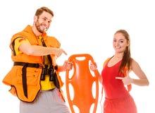 Lifeguards στη φανέλλα ζωής με το σημαντήρα διάσωσης Στοκ εικόνες με δικαίωμα ελεύθερης χρήσης