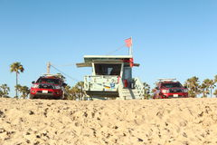 Lifeguards at Beach. Beach scene, California. Lifeguard booth and trucks stock photography