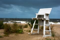 Lifeguards chair on a beach during a storm stock photography