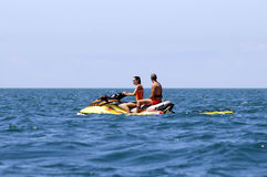 Lifeguards Couple on a Jet Ski Royalty Free Stock Photography