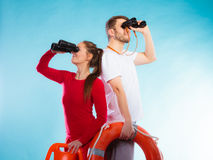 Lifeguards on duty looking through binoculars Royalty Free Stock Photos