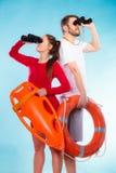 Lifeguards on duty looking through binoculars Royalty Free Stock Image