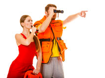 Lifeguards in life vest jacket whistling. Royalty Free Stock Images