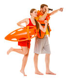 Lifeguards in life vest with rescue buoy running. Lifeguards with rescue tube buoy and life vest jacket looking through binoculars. Man and women supervising stock images