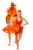 Lifeguards in life vest with rescue buoy running Stock Image