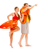 Lifeguards in life vest with rescue buoy running Royalty Free Stock Image