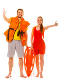 Lifeguards in life vest with rescue buoy. Success. Lifeguards with rescue tube buoy, life vest jacket and binoculars. Man and women supervising swimming pool stock image