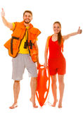 Lifeguards in life vest with rescue buoy. Success. Stock Image