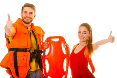 Lifeguards in life vest with rescue buoy. Success. Stock Photo