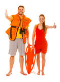 Lifeguards in life vest with rescue buoy. Success. royalty free stock image