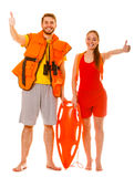 Lifeguards in life vest with rescue buoy. Success. royalty free stock photo