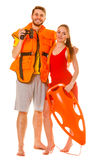 Lifeguards in life vest with rescue buoy. Lifeguards with rescue tube buoy and life vest jacket looking through binoculars. Man and women supervising swimming stock photos