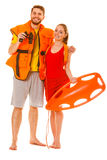 Lifeguards in life vest with rescue buoy. Lifeguards with rescue tube buoy and life vest jacket looking through binoculars. Man and women supervising swimming stock image