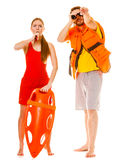Lifeguards in life vest with rescue buoy whistling Stock Photography