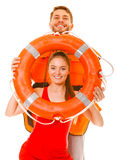 Lifeguards in life vest with ring buoy having fun. Stock Images