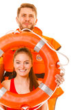 Lifeguards in life vest with ring buoy having fun. Happy lifeguards with ring buoy in life vest jacket. Man and women having fun. Accident prevention stock image