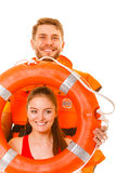 Lifeguards in life vest with ring buoy having fun. Happy lifeguards with ring buoy in life vest jacket. Man and women having fun. Accident prevention royalty free stock image