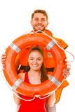 Lifeguards in life vest with ring buoy having fun. Stock Photography