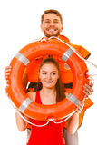 Lifeguards in life vest with ring buoy having fun. Stock Photos