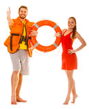 Lifeguards in life vest with ring buoy. Success. Lifeguards with ring buoy in life vest jacket. Man and women supervising swimming pool showing thumb up gesture stock photos