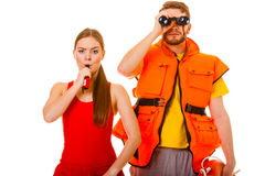 Lifeguards in life vest whistling. Stock Image