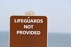 Lifeguards not provided sign Royalty Free Stock Photos