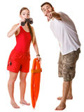 Lifeguards with rescue buoy and binoculars. royalty free stock images